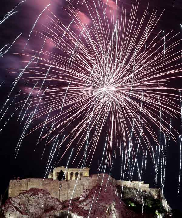 Fireworks explode over the ancient Acropolis Hill with the Parthenon temple during the New Year's celebrations in Athens, on Tuesday Jan. 1, 2013. (AP Photo/Dimitri Messinis)