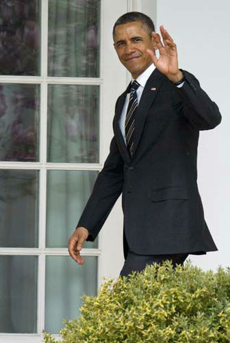 President Barack Obama waves as he enters the Oval Office of the White House in Washington, Monday, April 1, 2013,  after attending the White House Easter Egg Roll on the South Lawn. &#40;AP Photo&#47;Jacquelyn Martin&#41; <span class=meta>(AP Photo&#47; Jacquelyn Martin)</span>
