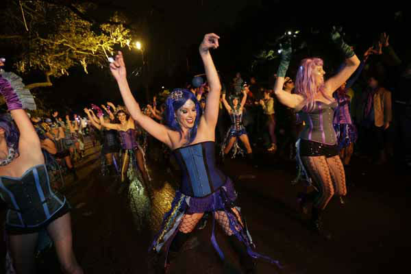 Members of the Mardi Gras dance group &#34;The Sirens&#34; perform during the Krewe of Orpheus Mardi Gras parade in New Orleans, Monday, Feb. 11, 2013. &#40;AP Photo&#47;Gerald Herbert&#41; <span class=meta>(AP Photo&#47; Gerald Herbert)</span>