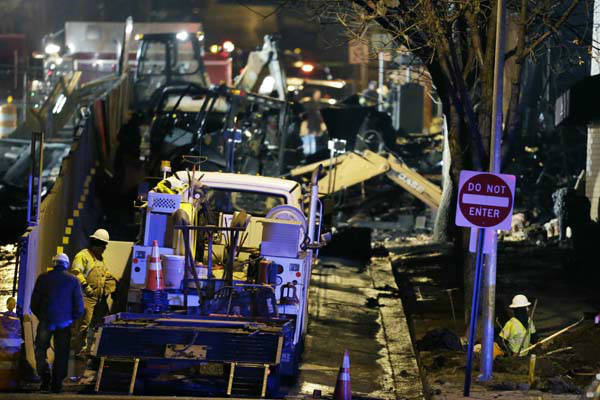 "<div class=""meta ""><span class=""caption-text "">Utility workers repair gas lines near a building that exploded and caught fire in the Plaza shopping district of Kansas City, Mo., Tuesday, Feb. 19, 2013. (AP Photo/Orlin Wagner) (AP Photo/ Orlin Wagner)</span></div>"