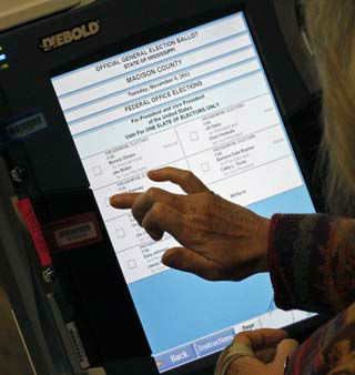 "<div class=""meta ""><span class=""caption-text "">A voter prepares casts her electronic ballot at this Madison, Miss., precinct, Tuesday, Nov. 6, 2012. Local officials expressed their pleasure with the large early turnout of voters. (AP Photo/Rogelio V. Solis) (AP Photo/ Rogelio V. Solis)</span></div>"