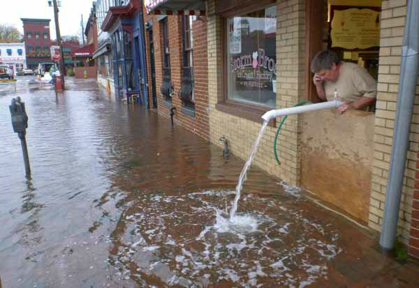Sveinn Storm pumps water out of his flooded Storm Bros. Ice Cream Factory store  in downtown Annapolis, Md. on Tuesday, Oct. 30, 2012, in the aftermath of Hurricane Sandy. High tide swept over the banks of the city dock, flooding lower Annapolis stores. &#40;AP Photo&#47;Blake Sell&#41; <span class=meta>(AP Photo&#47; Blake Sell)</span>