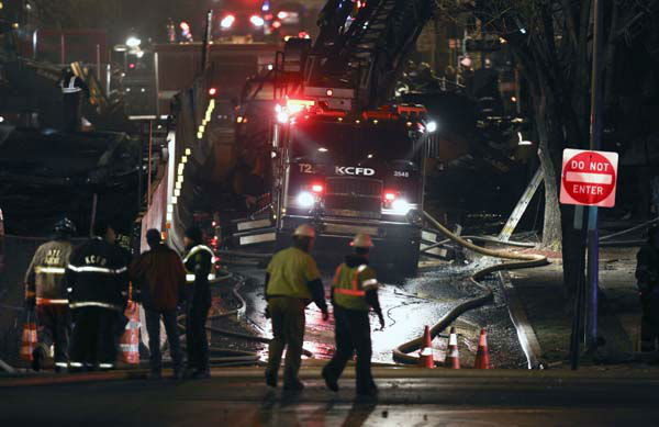 "<div class=""meta ""><span class=""caption-text "">Firemen and utility workers respond to a gas explosion and massive fire Tuesday night, Feb. 19, 2013 in the Plaza shopping district in Kansas City, Mo. A car crashed into a gas main in the upscale shopping district, sparking a massive blaze that engulfed an entire block and caused multiple injuries, police said  (AP Photo/Ed Zurga) (AP Photo/ Ed Zurga)</span></div>"