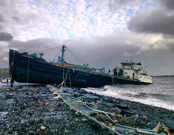 A 168-foot water tanker, the John B. Caddell, sits on the shore Tuesday morning, Oct. 30, 2012 where it ran aground on Front Street in the Stapleton neighborhood of New York&#39;s Staten Island as a result of superstorm Sandy. &#40;AP Photo&#47;Sean Sweeney&#41; <span class=meta>(AP Photo&#47; Sean Sweeney)</span>