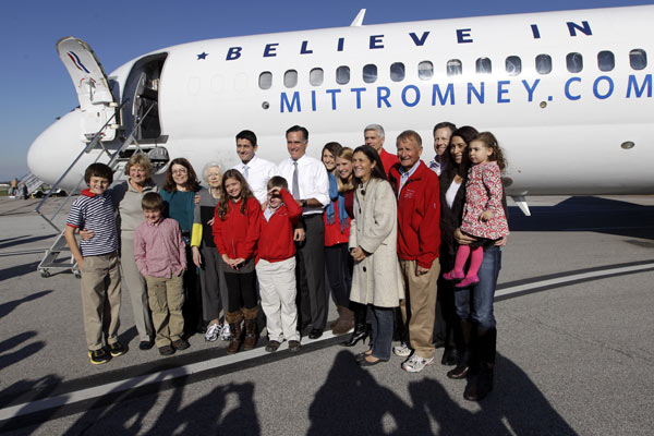 "<div class=""meta ""><span class=""caption-text "">Republican presidential candidate, former Massachusetts Gov. Mitt Romney and his running mate Rep. Paul Ryan, R-Wis., pose with members of Ryan's family at Cleveland Hopkins International airport, Tuesday, Nov. 6, 2012 in Cleveland, Ohio.  (AP Photo/Mary Altaffer)</span></div>"