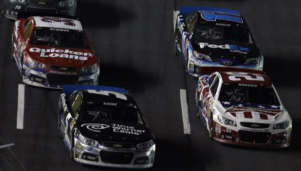 Kasey Kahne &#40;5&#41; and Kevin Harvick &#40;29&#41; race for position during a restart in the NASCAR Sprint Cup Series Coca-Cola 600 auto race at the Charlotte Motor Speedway in Concord, N.C., Sunday, May 26, 2013. Harvick went on to win the race. &#40;AP Photo&#47;Gerry Broome&#41; <span class=meta>(AP Photo&#47; Gerry Broome)</span>