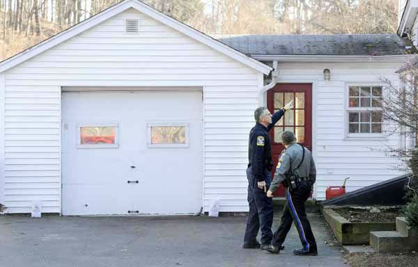 Law enforcement canvass an area nearby a school shooting at the Sandy Hook Elementary School in Newtown, Conn., about 60 miles &#40;96 kilometers&#41; northeast of New York City, Friday, Dec. 14, 2012. An official with knowledge of Friday&#39;s shooting said 27 people were dead, including 18 children. &#40;AP Photo&#47;Jessica Hill&#41; <span class=meta>(AP Photo&#47; Jessica Hill)</span>