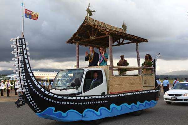 Britain&#39;s Prince William and his wife Kate, the Duke and Duchess of Cambridge, wave on a truck decorated as a canoe,  as they depart Honiara International Airport, Solomon Islands, Sunday, Sept. 16, 2012.   &#40;AP Photo&#47;Rick Rycroft&#41; <span class=meta>(AP Photo&#47; Rick Rycroft)</span>