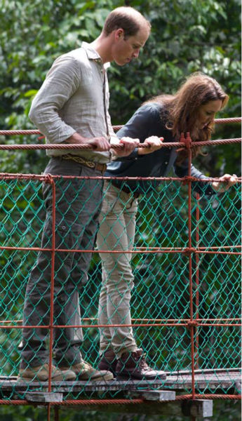 "<div class=""meta image-caption""><div class=""origin-logo origin-image ""><span></span></div><span class=""caption-text"">Britain's Prince William, left, and Kate, the Duchess of Cambridge look down on the three-hundred meter in length Canopy Walkway during their visit at the Borneo Rainforest Lodge in Danum Valley, some 70 kilometers (44 miles) west of Lahad Datu, on the island of Borneo Saturday, Sept. 15, 2012. (AP Photo/Mohd Rasfan, Pool) (AP Photo/ Mohd Rasfan)</span></div>"