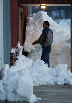 An unidentified voter walks past piles of snow to enter the polling place in Terra Alta, W. Va., to cast his ballot in the general election Tuesday, Nov. 6, 2012. Many voters were found relief in being able to vote despite the heavy snow and damage caused by superstorm Sandy. &#40;AP Photo&#47;Dave Martin&#41; <span class=meta>(AP Photo&#47; Dave Martin)</span>