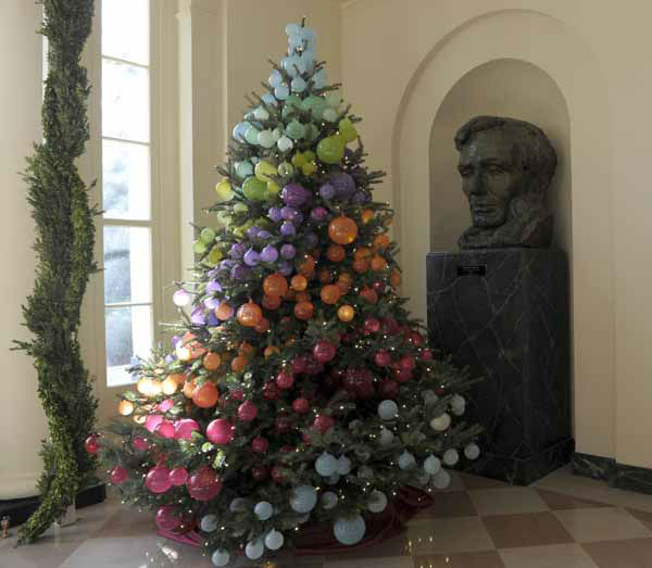 A Christmas tree decorated in a rainbow of colors sits next to a statue of President Lincoln in the East Garden Room of the White House in Washington, Wednesday, Nov. 28, 2012. The theme for the White House Christmas 2012 is Joy to All. &#40;AP Photo&#47;Susan Walsh&#41; <span class=meta>(AP Photo&#47; Susan Walsh)</span>