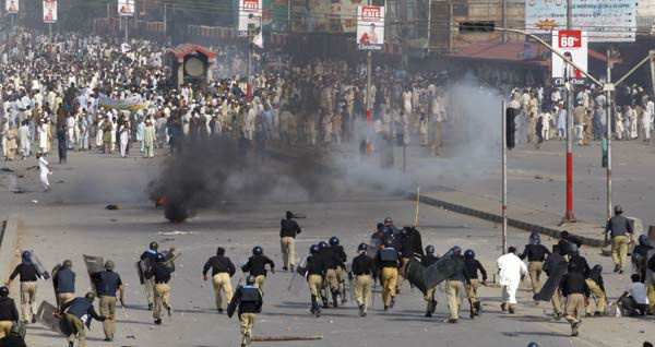Police chase protesters during an anti-U.S. rally in Peshawar, Pakistan, Friday, Sept 21, 2012. Tens of thousands protested around the country against an anti-Muslim film after the government encouraged peaceful protests and declared a national holiday --? &#34;Love for the Prophet Day.&#34; Demonstrations turned violent and over a dozen people were killed. &#40;AP Photo&#47;Mohammad Sajjad&#41; <span class=meta>(AP Photo&#47; Mohammad Sjjad)</span>