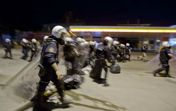 "<div class=""meta image-caption""><div class=""origin-logo origin-image ""><span></span></div><span class=""caption-text"">Turkish riot police dismantle a barricade during clashes with protesters in Ankara, Turkey, Tuesday, June 11, 2013. Turkey's Prime Minister Recep Tayyip Erdogan will meet with a group of protesters occupying Istanbul's central Taksim Square this week, Deputy Prime minister Bulent Arinc said Monday, as the government sought a way out of the impasse that has led to hundreds of protests in dozens of cities.  (AP Photo/Vadim Ghirda) (AP Photo/ Vadim Ghirda)</span></div>"