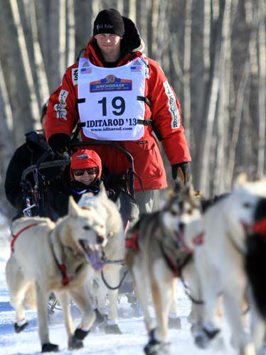 Dallas Seavey, 2012 Iditarod champion, drives his team during the ceremonial start of the Iditarod Trail Sled Dog Race Saturday, March 2, 2013, in Anchorage, Alaska. The competitive portion of the 1,000-mile race is scheduled to begin Sunday in Willow, Alaska. &#40;AP Photo&#47;Dan Joling&#41; <span class=meta>(AP Photo&#47; Dan Joling)</span>