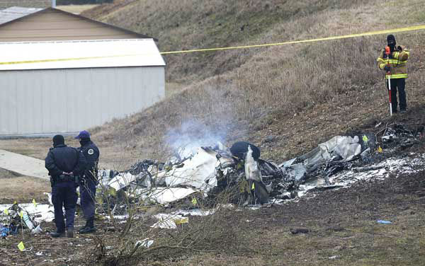 "<div class=""meta image-caption""><div class=""origin-logo origin-image ""><span></span></div><span class=""caption-text"">Investigators examine the site of a plane crash Tuesday, Feb. 4, 2014 near Nashville.  The small plane crashed on Monday,  near a YMCA in suburban Nashville, killing everyone on board and damaging cars in the parking lot. Authorities believe four members of the same family were on board the flight, which crashed near in Bellevue.   The Gulfstream 690C departed from Great Bend Municipal Airport in Great Bend, Kansas, Monday afternoon around 2:45 p.m.,  and crashed 16 kilometres south of John C. Tune Airport in Nashville about 5 p.m.  (AP Photo/Mark Zaleski) (Photo/Mark Zaleski)</span></div>"