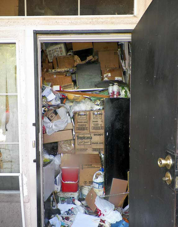 This photo provided by the City of Las Vegas via the Las Vegas Review-Journal shows the interior of hoarder Kenneth Epstein&#39;s home during a cleanup attempt in Las Vegas. Officials began hauling away items from Kenneth Epstein&#39;s home on Friday, Oct. 5, 2012 after they found materials stacked from floor to ceiling inside and declared it uninhabitable, the Las Vegas Review-Journal reported. In all, a private removal company was working with officials to remove about 15 truckloads of materials. &#40;AP Photo&#47;City of Las Vegas via Las Vegas Review-Journal&#41; <span class=meta>(AP Photo&#47; Uncredited)</span>