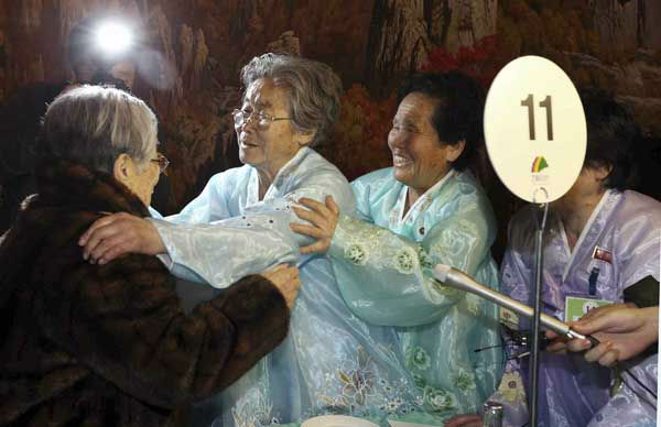 South Korean Kim Sung-yoon, 96, left, meets with her North Korean family members during the Separated Family Reunion Meeting at Diamond Mountain resort in North Korea, Thursday, Feb. 20, 2014. Elderly North and South Koreans separated for six decades are tearfully reuniting, grateful to embrace children, brothers, sisters and spouses they had thought they might never see again. &#40;AP Photo&#47;Yonhap, Lee Ji-eun&#41;  KOREA OUT <span class=meta>(Photo&#47;Lee Ji-eun)</span>