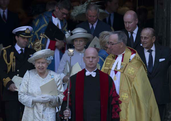 "<div class=""meta ""><span class=""caption-text "">Britain's Queen Elizabeth II, escorted by the Dean of  Westminster Abbey, Dr John Hall, 2nd right, leaves through the west door after a service to celebrate the 60th anniversary of her coronation at Westminster Abbey, London, Tuesday, June  4, 2013. (AP Photo/Alastair Grant) (AP Photo/ Alastair Grant)</span></div>"