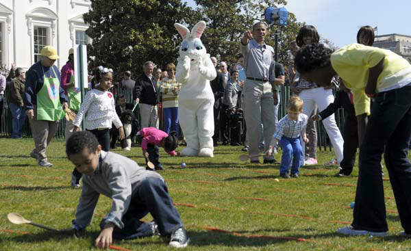 President Barack Obama, standing next to the Easter Bunny, accompanied by first lady Michelle Obama, points to five-year-old Donovan Frazier as he participated in the annual Easter Egg Roll on the South Lawn of the White House in Washington, Monday, April 1, 2013. &#40;AP Photo&#47;Susan Walsh&#41; <span class=meta>(AP Photo&#47; Susan Walsh)</span>