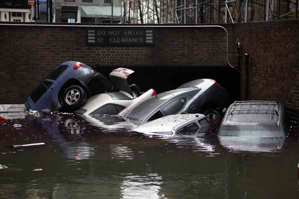 Cars are submerged at the entrance to a parking garage in New York&#39;s Financial District in the aftermath of superstorm Sandy, Tuesday, Oct. 30, 2012. New York City awakened Tuesday to a flooded subway system, shuttered financial markets and hundreds of thousands of people without power a day after a wall of seawater and high winds slammed into the city, destroying buildings and flooding tunnels.  &#40;AP Photo&#47;Richard Drew&#41; <span class=meta>(AP Photo&#47; Richard Drew)</span>