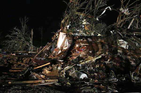 Debris is scattered in what was a mobile home park where a tornado struck near Dale, Okla., Sunday, May 19, 2013. &#40;AP Photo Sue Ogrocki&#41; <span class=meta>(AP Photo&#47; Sue Ogrocki)</span>