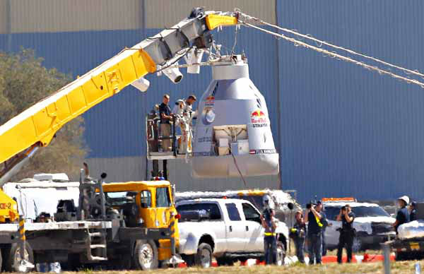 "<div class=""meta ""><span class=""caption-text "">Felix Baumgartner disembarks from the balloon capsule after his mission was aborted in Roswell, N.M. on Tuesday, Oct. 9, 2012. Baumgartner was attempting to break the speed of sound with his own body by jumping from the capsule lifted 23 miles high by a 30 million cubic foot helium balloon. (AP Photo/Matt York) (AP Photo/ Matt York)</span></div>"