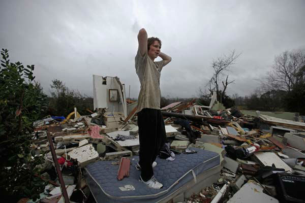 Will Carter, 15, surveys the damage to his house upon arriving home from school following a tornado, Wednesday, Jan. 30, 2013, in Adairsville, Ga. &#40;AP Photo&#47;David Goldman&#41; <span class=meta>(AP Photo&#47; David Goldman)</span>