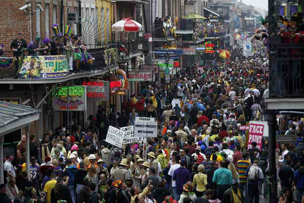 Crowds of revelers are seen on Bourbon Street from the balcony of the Royal Sonesta Hotel during Mardi Gras in New Orleans, Tuesday, Feb. 12, 2013. Despite threatening skies, the Mardi Gras party carried on as thousands of costumed revelers cheered glitzy floats with make-believe monarchs in an all-out bash before Lent.   Crowds were a little smaller than recent years, perhaps influenced by the forecast of rain. Still, parades went off as scheduled even as a fog settled over the riverfront and downtown areas. (AP Photo/Gerald Herbert)