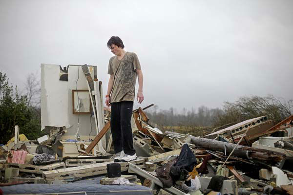 Will Carter, 15, surveys the damage to his house upon arriving home from school following a tornado, Wednesday, Jan. 30, 2013, in Adairsville, Ga. A fierce storm system that roared across Georgia has left at least one person dead after it demolished buildings and flipped vehicles on Interstate 75 northwest of Atlanta. &#40;AP Photo&#47;David Goldman&#41; <span class=meta>(AP Photo&#47; David Goldman)</span>