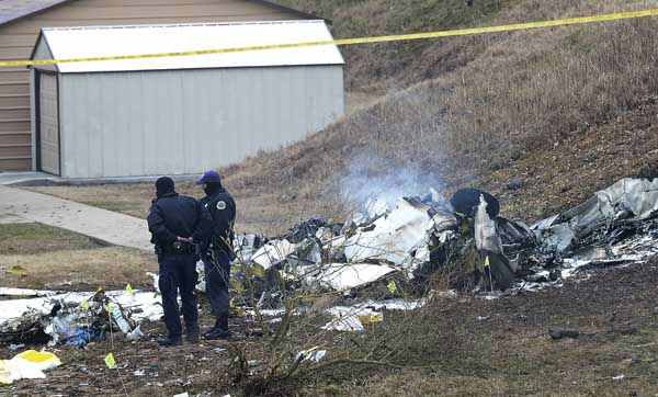 "<div class=""meta ""><span class=""caption-text "">Investigators examine the site of a plane crash Tuesday, Feb. 4, 2014 near Nashville.  The small plane crashed on Monday,  near a YMCA in suburban Nashville, killing everyone on board and damaging cars in the parking lot. Authorities believe four members of the same family were on board the flight, which crashed near in Bellevue.   The Gulfstream 690C departed from Great Bend Municipal Airport in Great Bend, Kansas, Monday afternoon around 2:45 p.m.,  and crashed 16 kilometres south of John C. Tune Airport in Nashville about 5 p.m.  (AP Photo/Mark Zaleski) (Photo/Mark Zaleski)</span></div>"