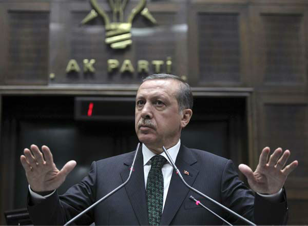 Turkey&#39;s Prime Minister Recep Tayyip Erdogan gestures as he addresses lawmakers and supporters of his ruling Justice and Development Party at the parliament in Ankara, Turkey, Tuesday, June 11, 2013. A peaceful public demonstration against the redevelopment of a city park has changed into clashes between protesters and police in a test of Prime Minister Erdogan&#237;s authority, and as clashes continue Tuesday, Erdogan made it more than clear that he had come to the end of his tolerance. &#40;AP Photo&#41; <span class=meta>(AP Photo)</span>