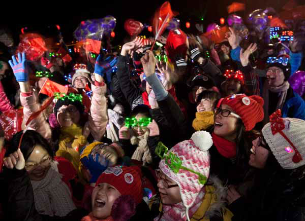 Chinese revelers celebrate the new year during a count-down event at the Summer Palace in Beijing Tuesday, Jan. 1, 2013. &#40;AP Photo&#47;Andy Wong&#41; <span class=meta>(AP Photo&#47; Andy Wong)</span>