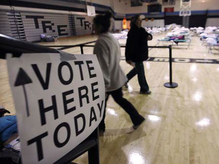 People walk through a makeshift shelter in a gymnasium at Toms River East High School as they arrive to vote Tuesday, Nov. 6, 2012, in Toms River, N.J. Voter turnout was heavy in several storm-ravaged Jersey Shore towns, with many voters expressing relief and even elation at being able to vote at all, considering the devastation.  &#40;AP Photo&#47;Mel Evans&#41; <span class=meta>(AP Photo&#47; Mel Evans)</span>