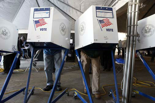 Voters fill out their ballots under a tent at a consolidated polling station for residents of the Rockaways on election day, Tuesday, Nov. 6, 2012, in the Queens borough of New York. Election Day turnout was heavy in several storm-ravaged areas in New York and New Jersey, with many voters expressing relief and even elation at being able to vote at all, considering the devastation.  &#40;AP Photo&#47;Jason DeCrow&#41; <span class=meta>(AP Photo&#47; Jason DeCrow)</span>