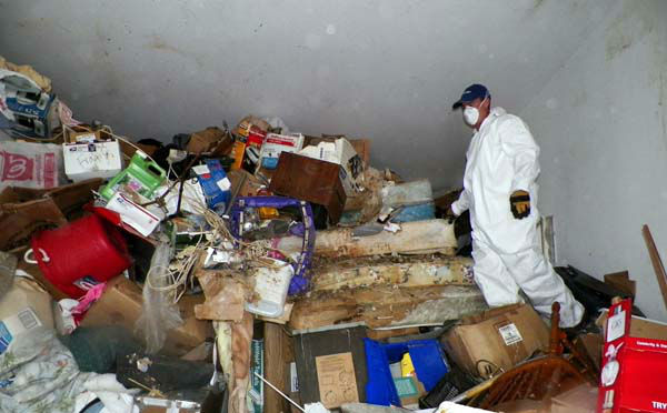 This photo provided by the City of Las Vegas via the Las Vegas Review-Journal shows a worker during a cleanup of hoarder Kenneth Epstein&#39;s home in Las Vegas. Officials began hauling away items from Kenneth Epstein&#39;s home on Friday, Oct. 5, 2012 after they found materials stacked from floor to ceiling inside and declared it uninhabitable, the Las Vegas Review-Journal reported. In all, a private removal company was working with officials to remove about 15 truckloads of materials. &#40;AP Photo&#47;City of Las Vegas via Las Vegas Review-Journal&#41; <span class=meta>(AP Photo&#47; Uncredited)</span>