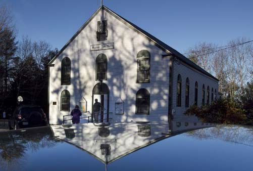 Voters chat while waiting for the polls to open at the 221-year-old Town Hall on Westport Island, Maine, Tuesday, Nov. 6, 2012. &#40;AP Photo&#47;Robert F. Bukaty&#41; <span class=meta>(AP Photo&#47; Robert F. Bukaty)</span>