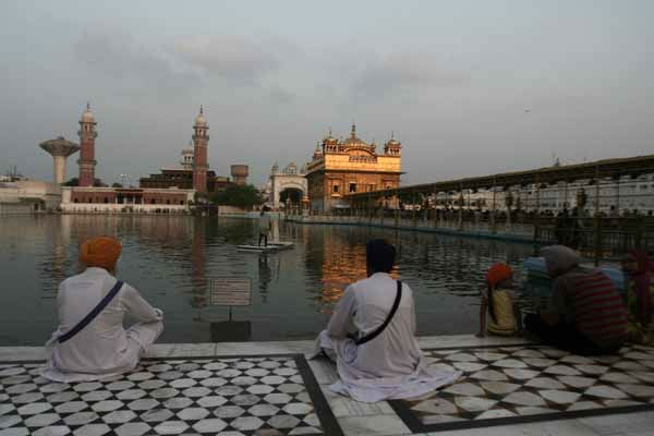 Indian Sikh devotees offer prayers at the Golden Temple, Sikh&#39;s holiest shrine in Amritsar, India, Monday, Aug. 6, 2012. Indian Prime Minister Manmohan Singh said Monday that he was shocked and saddened by the shooting attack that killed six people at a Sikh house of worship in the U.S. state of Wisconsin. &#40;AP Photo&#47;Sanjeev Syal&#41; <span class=meta>(AP Photo&#47; Sanjeev Syal)</span>