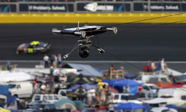 A cable rig on a television camera hangs broken over the track at the NASCAR Sprint Cup Series Coca-Cola 600 auto race at the Charlotte Motor Speedway in Concord, N.C., Sunday, May 26, 2013. The race was red flagged as a result. Several cars ran over the cable, damaging the race cars. &#40;AP Photo&#47;Gerry Broome&#41; <span class=meta>(AP Photo&#47; Gerry Broome)</span>