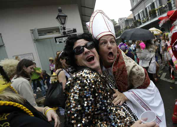 "<div class=""meta ""><span class=""caption-text "">A man dressed as the Pope revels with other costumed people during Mardi Gras in the French Quarter of New Orleans, Tuesday, Feb. 12, 2013. Despite threatening skies, the Mardi Gras party carried on as thousands of costumed revelers cheered glitzy floats with make-believe monarchs in an all-out bash before Lent.   Crowds were a little smaller than recent years, perhaps influenced by the forecast of rain. Still, parades went off as scheduled even as a fog settled over the riverfront and downtown areas. (AP Photo/Gerald Herbert)</span></div>"