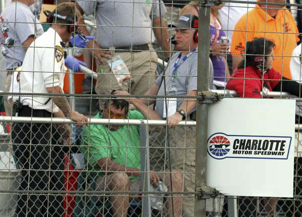 In this photo provided by Fernando Echeverria, security personnel assist a fan injured by a broken television camera cable during the NASCAR Sprint Cup series Coca-Cola 600 auto race at Charlotte Motor Speedway in Concord, N.C., Sunday, May 26, 2013. &#40;AP Photo&#47;Fernando Echeverria&#41; <span class=meta>(AP Photo&#47; Fernando Echeverria)</span>