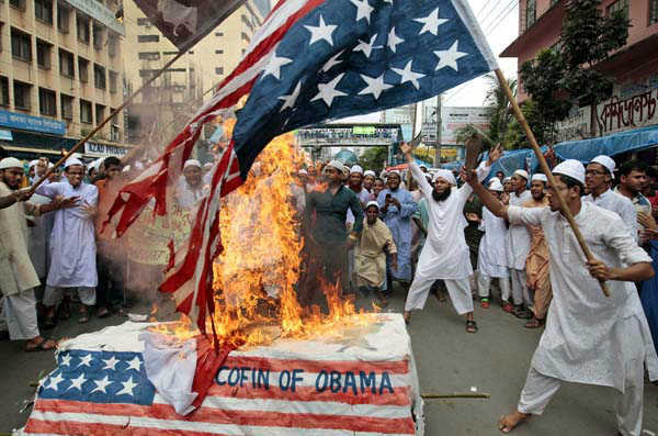 Bangladeshi Muslims burn a U.S. flag and a coffin of U.S. President Barack Obama during a protest in Dhaka, Bangladesh, Friday, Sept. 21, 2012. The protest was against an anti-Islam film called &#34;Innocence of Muslims&#34; that ridicules Islam&#39;s Prophet Muhammad. &#40;AP Photo&#47;A.M. Ahad&#41; <span class=meta>(AP Photo&#47; A.M. Ahad)</span>