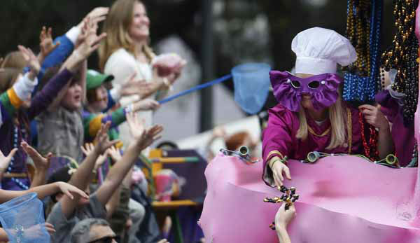 Hands reach for beads thrown from a float in the Mardi Gras Iris parade as it rolls through the streets of New Orleans,  Saturday, Feb. 9, 2013.&#40;AP Photo&#47;Bill Haber&#41; <span class=meta>(AP Photo&#47; Bill Haber)</span>