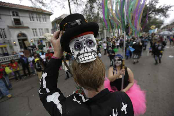 A reveler shows off his mask during the Krewe of Okeanos parade in New Orleans, Sunday, Feb. 10, 2013. &#40;AP Photo&#47;Gerald Herbert&#41; <span class=meta>(AP Photo&#47; Gerald Herbert)</span>