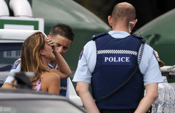 "<div class=""meta ""><span class=""caption-text "">Police comfort a woman believed to be a family member of a man attacked by a shark at  Muriwai Beach near Auckland, New Zealand, Wednesday, Feb. 27, 2013. Police said a man was found dead in the water after being ""bitten by a large shark."" (AP Photo/Ross Land) NEW ZEALAND OUT, NO SALES (AP Photo/ Ross Land)</span></div>"