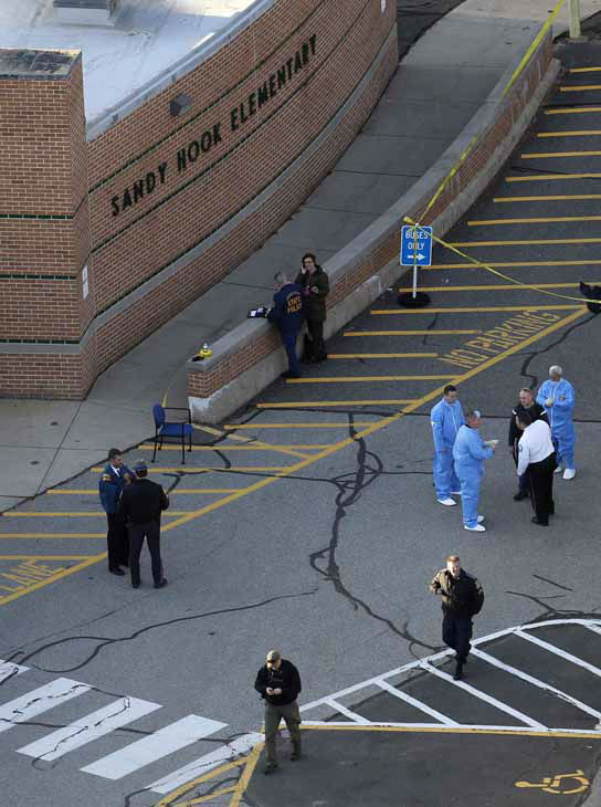 "<div class=""meta ""><span class=""caption-text "">Officials are on the scene outside of Sandy Hook Elementary School in Newtown, Conn., where authorities say a gunman opened fire inside an elementary school in a shooting that left 27 people dead, including 20 children, Friday, Dec. 14, 2012. (AP Photo/Julio Cortez) (Photo/Julio Cortez)</span></div>"