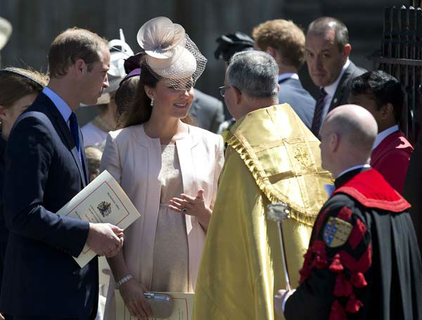 Britain&#39;s Prince William, left, and his wife Kate, Duchess of Cambridge, talk to the Dean of Westminster Abbey, Dr John Hall, as they leave following a service to celebrate the 60th anniversary of the coronation of Britain&#39;s Queen Elizabeth II at Westminster Abbey, London, Tuesday, June  4, 2013. &#40;AP Photo&#47;Alastair Grant&#41; <span class=meta>(AP Photo&#47; Alastair Grant)</span>