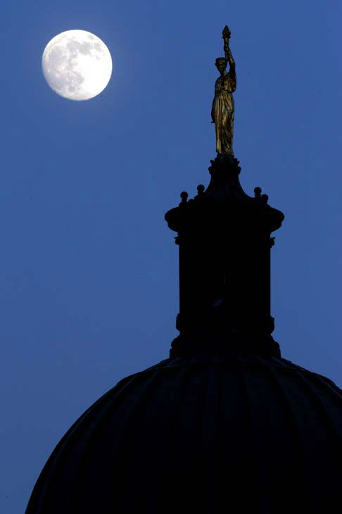 "<div class=""meta image-caption""><div class=""origin-logo origin-image ""><span></span></div><span class=""caption-text"">The moon in its waxing gibbous stage is shines behind a statue entitled ""Enlightenment Giving Power"" by John Gelert, which sits at the top of the dome of the Bergen County Courthouse in Hackensack, N.J., Friday, June 21, 2013. The moon, which will reach its full stage on Sunday, is expected to be 13.5 percent closer to earth during a phenomenon known as supermoon. (AP Photo/Julio Cortez) (AP Photo/ Julio Cortez)</span></div>"