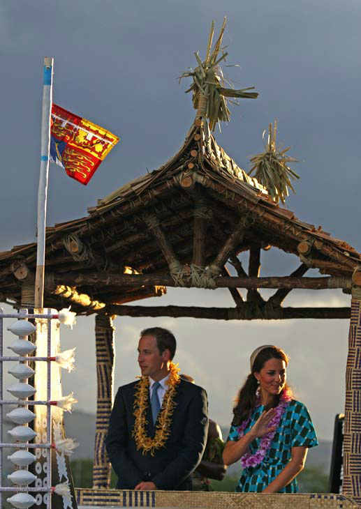 "<div class=""meta ""><span class=""caption-text "">Britain's Prince William, left, and his wife Kate, the Duke and Duchess of Cambridge, wave on the back of a truck decorated like as a canoe  following a welcome ceremony in Honiara, Solomon Islands, Sunday, Sept. 16, 2012.  (AP Photo/Rick Rycroft) (AP Photo/ Rick Rycroft)</span></div>"