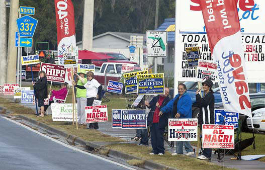 "<div class=""meta ""><span class=""caption-text "">Friends and campaign workers line the highway across  from the voting headquarters in Bronson, Fla., Tuesday, Nov. 6, 2012.  Despite the national interest in the preisidential race, there are no presidential campaign signs urging voters to pick those candidates. AP Photo/Phil Sandlin) (AP Photo/ PHIL SANDLIN)</span></div>"