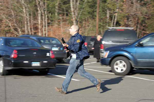 In this photo provided by the Newtown Bee, a state police officer runs outside of Sandy Hook Elementary School in Newtown, Conn., where authorities say a gunman opened fire, killing 26 people, including 20 children, Friday, Dec. 14, 2012. &#40;AP Photo&#47;Newtown Bee, Shannon Hicks&#41; MANDATORY CREDIT: NEWTOWN BEE, SHANNON HICKS <span class=meta>(AP Photo&#47; Shannon Hicks)</span>